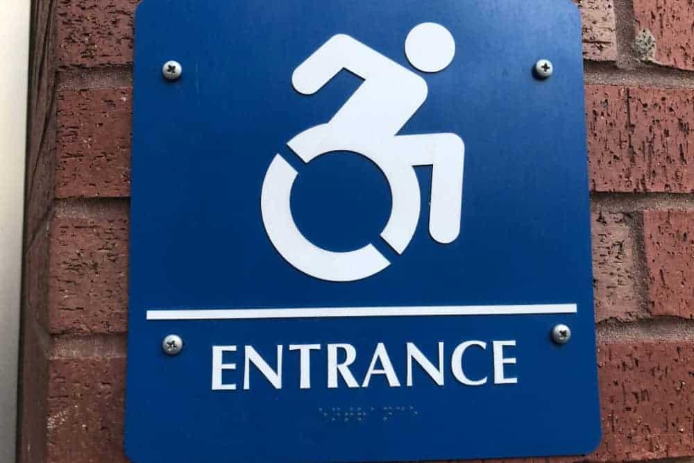 Wheelchair accessible entrance ADA compliance sign