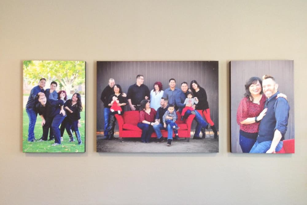 Interior wall with canvas prints of family members